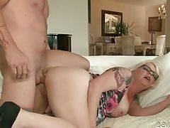 Pretty tattooed lady gets thoroughly pounded doggy style.